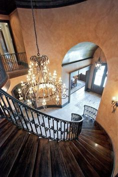 Traditional Staircase with Wall sconce, Metal staircase, Hardwood floors, High ceiling