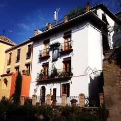 Home on the opposite side of the creek along the Carrera del Darro
