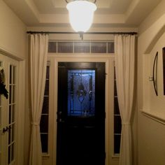 Hang curtains around the front door to close at night for added privacy! Love that I did this!