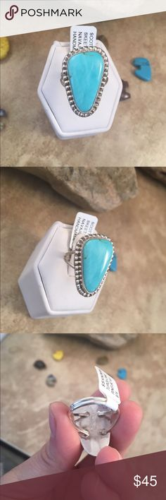 Navajo Kingman Turquoise & Sterling Ring Size 8.5 This is a wonderful piece made by Scott Skeets it is made of Sterling Silver and Kingman Turquoise. This ring is a size 8.5 and is right at 1 1/8 inches long and 3/4 of an inch wide. The ring is signed by the artist and stamped sterling.    Please contact me with any questions and thank you for looking. Jewelry Rings