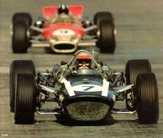 Lucien Bianchi (Cooper Car co.) with Graham Hill (Gold Leaf Team Lotus) at the 1968 Monaco Grand Prix.