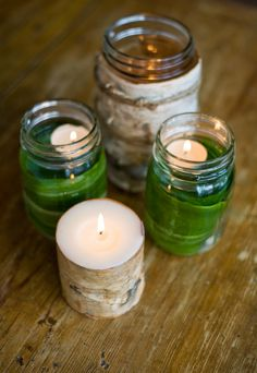 Candle light - jar filled with hosta leaves, water and candle