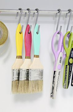 S-hooks are a simple way to neatly hang any supplies - paintbrushes, scissors, you name it!