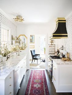 (BrandonRugs.com) When you are goin' crazy working out all of the details involved in redesigning your kitchen; keep your mind and remember that a distinctive handmade oriental rug is one of those details easily and inexpensively implemented.