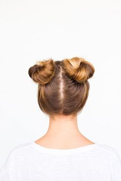 Recreate this DIY double bun hair tutorial at home and prove that two buns really are better than one. It will only take 5 minutes! #hairtutorial #updo