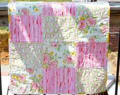 "Big Block Baby Quilt: Written tutorial using 3 fat quarters and a yard of fabric for backing and binding for making a stroller sized (30"" x 30"") quilt."