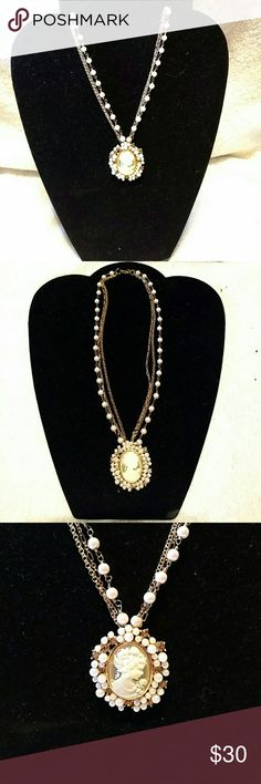 The Danbury Mint Cameo and Pearl Necklace The Danbury Mint Cameo And Pearl Necklace. Cameo is surrounded by synthetic Pearls and Crystals. The Danbury Mint Jewelry Necklaces
