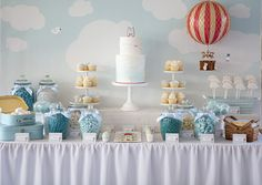 Michael's Hot Air Balloon Christening Dessert Table - Cake, cupcakes, cookies and marshmallows by Sweet Tiers. Styled by Styled By Belle - Melbourne.
