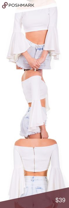 "Off The Shoulder Crop Top White off the shoulders crop top with a fun and flirty bell sleeves and a silver back zipper closure.   95% Polyester, 5% Rayon Model is wearing a US size small Model is 5'9"",bust 32"",waist 23.5"", hips 36"" Color: White Tops Crop Tops"