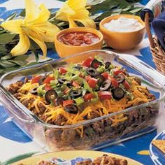 Taco Casserole--without the green peppers and beans and with green chiles. It always devoured when I make it for parties!