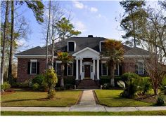 """3447 Henrietta Hartford Rd Mount Pleasant, SC @ Park West.  This """"Southern Living"""" custom built, all brick, one level home is located on a large corner lot in one of Mt. Pleasants finest communities. It features a large open living area with raised gas fireplace and marble hearth. Open dining room with half walls and marble tops with columns. Pocket doors open to a large study."""