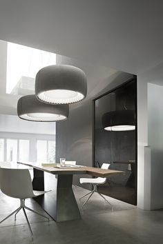 Silenzio by Luceplan - Suspended lamp and an acoustic solution.