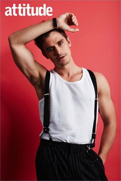 Antoni Porowski wears Moschino trousers and suspenders.
