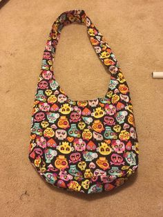 A personal favorite from my Etsy shop https://www.etsy.com/listing/280994712/sugar-skull-hobo-bag