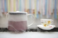 DIY Wedding, Lavender 'Tea' Cocktail in vintage china from tea pots with dry ice, reception drink