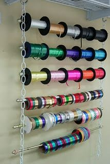 Ribbon & spool rods on chains: creative craft room storage
