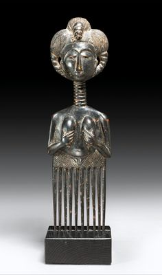 Africa | Comb from the Asante people of Ghana | Wood; dark shiny patina