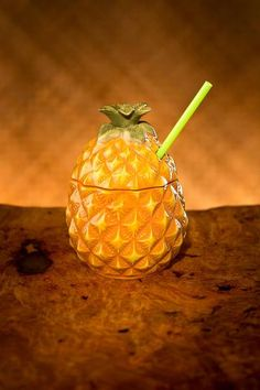 A symbol of the Islands, this porcelain pineapple is used to serve our Pino Pepe cocktail, a blend of fresh pineapple vodka, light rum. Ceramic Tiki Mug Tropical