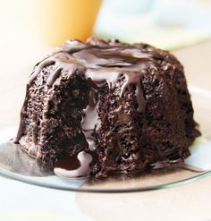 Try Godiva Molten Chocolate Bundt cake! You'll just need 4 oz Godiva dark chocolate Callets, cup boiling water, 1 tbs espresso powder, 1 cup sour cream. Köstliche Desserts, Delicious Desserts, Yummy Food, Sweet Street Desserts, Volcano Cake, Cake Recipes, Dessert Recipes, Molten Lava Cakes, Chocolate Lava Cake