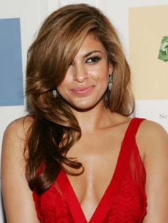 Eva Mendes.. I think she is absolutely GORGEOUs and so is her hair !!