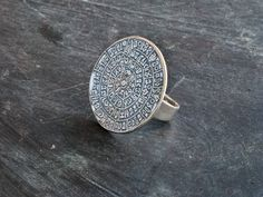 Hey, I found this really awesome Etsy listing at https://www.etsy.com/listing/219387764/greek-phaistos-disc-ring-sterling-silver