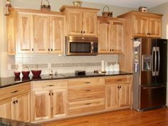 Hickory cabinets, darker counters, and simple backsplash with simple hardware Natural Hickory Cabinets, Rustic Hickory Cabinets, Rustic Kitchen Cabinets, Kitchen Redo, New Kitchen, Kitchen Remodel, Kitchen Layout, Kitchen Dining, Kitchen Ideas