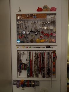 IKEA Ribba frame, chicken wire, cork, carbon tube and hangers.     A fantastic way to display your jewelry.