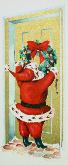 Vintage Christmas Card - Santa hangs a wreath on the door