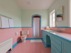The pastel colors in this bathroom are just dreamy and, while I might prefer a full bath, that gorgeous vanity certainly makes up for the lack of a tub.
