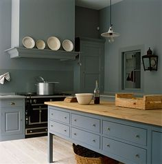 Beautiful complex blue/green/gray color. Possibly Farrow and Ball Castle Gray or Oval Room Blue. Cabinets look like Plain English.