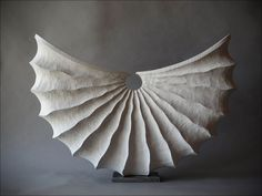 It's not ceramic, but it could be!  White shell, 53 cm