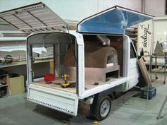 Secret Pizza Society's Piaggio Ape being converted to accommodate the wood fired oven!