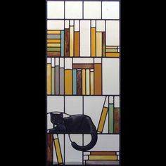 Stained glass panel with cat and bookshelf by Bridport Stained Glass