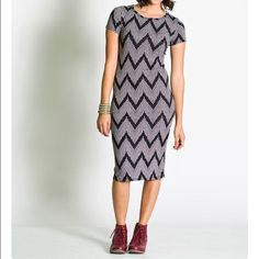 Lula Roe Julia Dress - Small Midi dress by LuLaRoe. This dress is very versatile and can be dressed up and down depending on how you style it. Made of 94% polyester 6% spandex - this dress is simply comfortable. LuLaRoe Dresses Midi