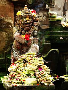 """Balinese Hindu temple. Offering to barong ket, the lion guardian of the """"good"""" spirits of nature"""