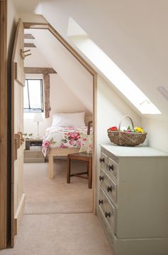 Space is utilised in the hallway with vintage drawers and flowers