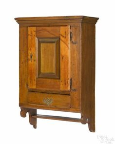 Pennsylvania poplar hanging cupboard, late 18th c., with a raised panel door and original rattail hinges, 37 1/4'' h., 23'' w. Provenance: The Collection