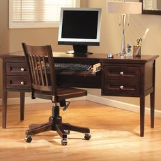 This Whittier Wood McKenzie Desk has four drawers and a solid wood plank desktop. The pencil drawer has a flip down front for a computer keyboard tray.
