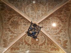 repeat pattern on groin ceiling - not sure about the scale of the light fixture but love the ceiling treatment