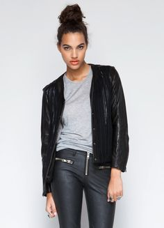 Double your pleasure and double your radness with this leather jacket and sweater in one by Capulet. Features two front pockets and zipper closure.  100% Cotton 24 length Model is wearing size S