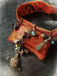 Gypsy amulet necklace with richly embroidered  deep orange