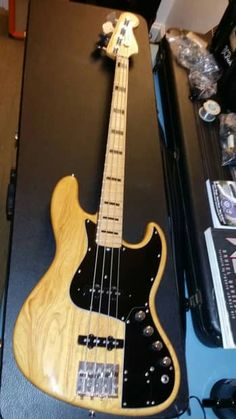 """This awesome hybrid Fender Jazz bass combines the power, punch, clarity and versatility of the Marcus Miller Signature Jazz bass with the ease of playing from a brand new 2016 Fender Geddy Lee Jazz bass neck. Not only do the black blocks and binding look better with the black Marcus pickguard, but the super thin and super fast features of the Geddy neck make this an incredibly comfortable and versatile bass that will easily become your """"go to"""" Jazz for stage or studio. This bass ..."""