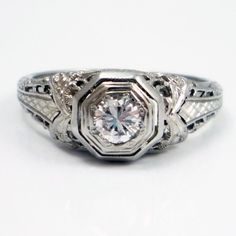 the Art Deco engagement ring that's sitting pretty on my finger - the rest of my jewelry will reflect that style