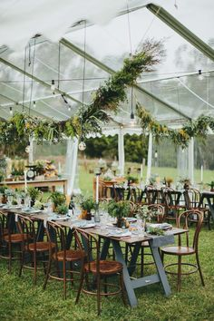 Hanging greenery, hanging lights and rustic wood and metal accents for reception décor.