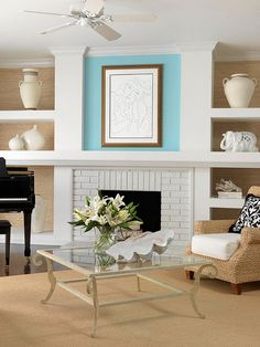Blank Canvas      To maintain a light and airy look, use blue as an accent in a space filled with neutral hues. In this neutral living room, a robin's egg blue infuses the space above the fireplace with subtle personality. The bright hue draws the eye above the mantel and beautifully showcases a piece of framed artwork.