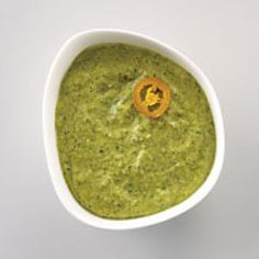 Poblano Pesto - try it on anything at Qdoba, as they'll add it in 4 free...not very hot at all, great flavor