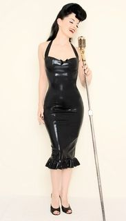 The spirit of Elvis incarnate with a patent leather whip. Hot rockabilly!