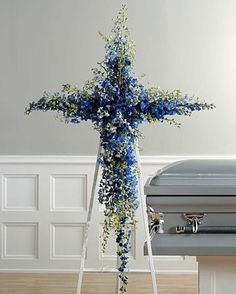 Beautiful floral cross funeral arrangement made using blue delphinium. Perfect for his funeral or memorial service. Church Flowers, Funeral Flowers, Wedding Flowers, Flowers Wallpaper, Wallpaper Art, Casket Flowers, Funeral Floral Arrangements, Funeral Sprays, Funeral Planning