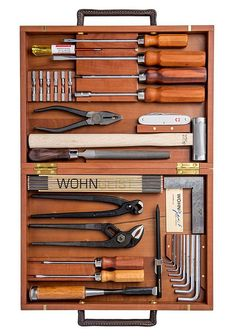 WohnGeist Tool Set -- This classic German tool set comes housed in a Swiss pear wood box with leather handles and inside, the assortment of essential, high-quality hand tools are held in place by magnets to keep them all organized.