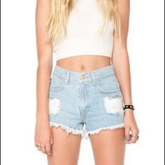 Brandy Melville high waisted denim shorts Flawless condition. Size on tag says 26 but they fit a size 25. Brandy Melville Shorts Jean Shorts